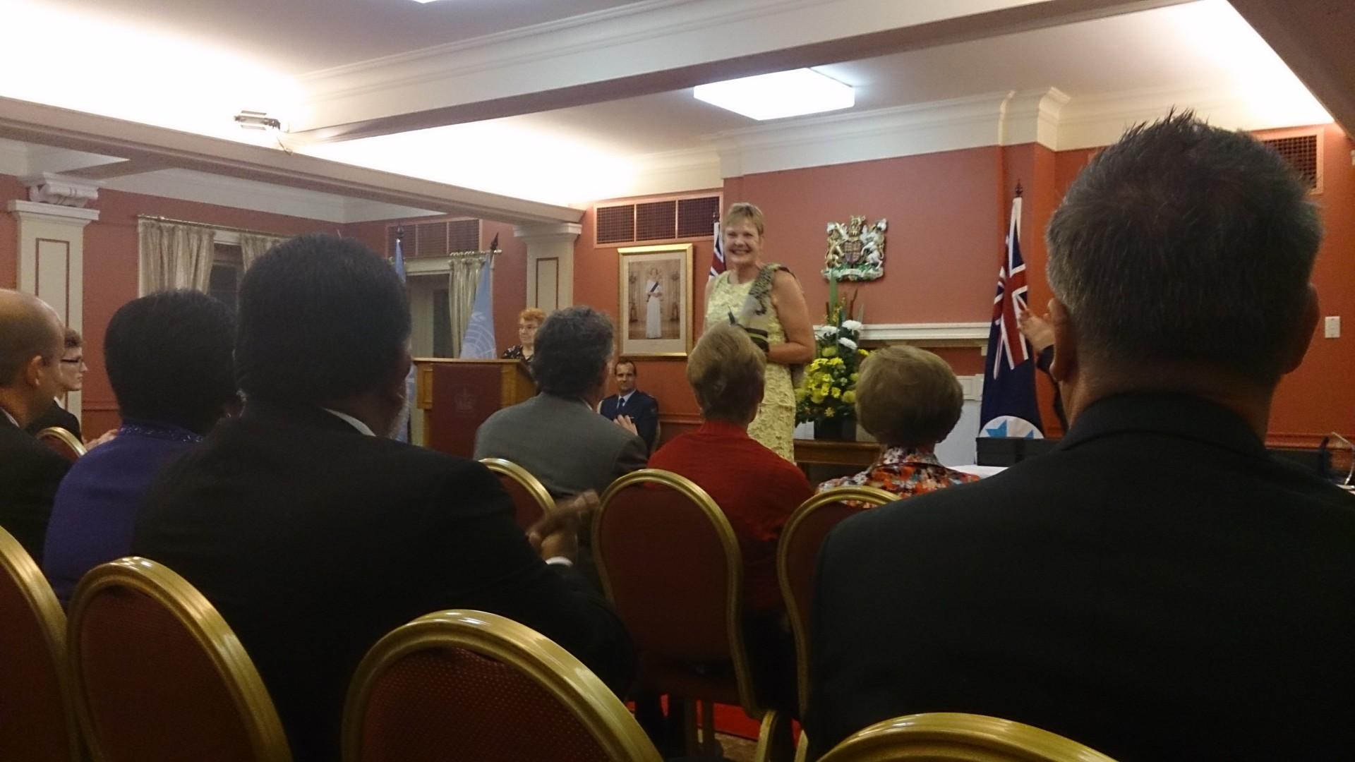 Judi accepts the UN Community award on behalf of the Zonta Club of Brisbane Breakfast.